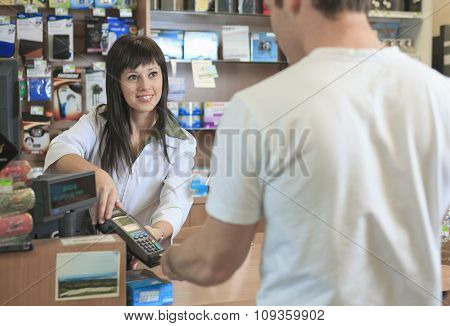 Pharmacist helping customer at counter place