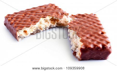Broken chocolate wafer, isolated on white