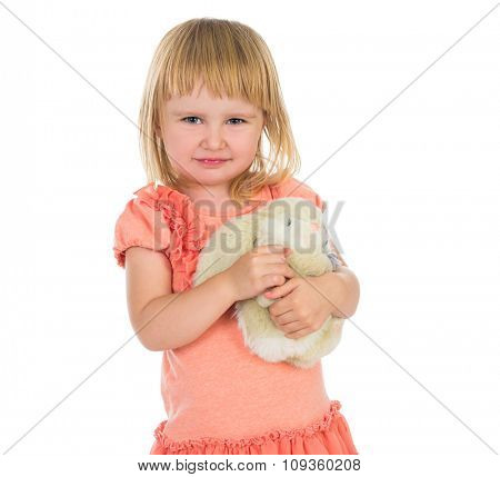 cute little girl holding toy bunny isolated on white background