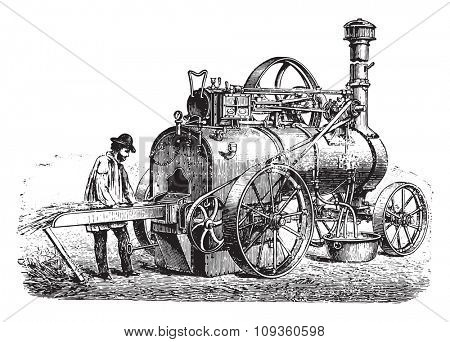 View of a portable engine heater with straw, vintage engraved illustration. Industrial encyclopedia E.-O. Lami - 1875.
