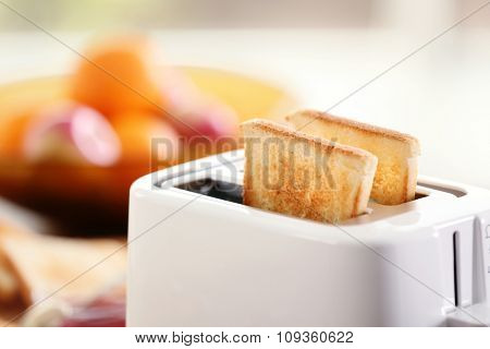 Served table for breakfast with toast and fruit, on blurred background