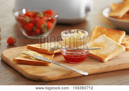 Served table for breakfast with toast and honey, close-up