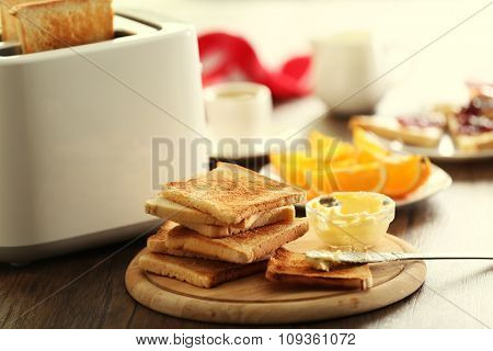 Served table for breakfast with toast and coffee, on blurred background