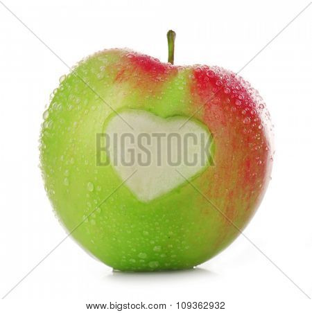 Apple with heart isolated on white