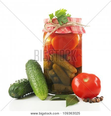 Jar of canned tomatoes and cucumbers isolated on white