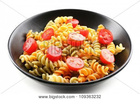 Delicious macaroni dish in black bowl isolated on white background
