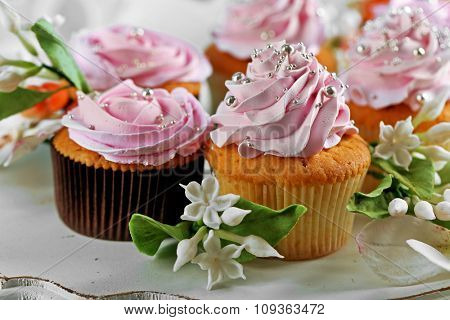 Tasty cupcakes on plate, close-up