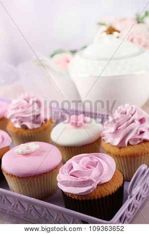 Tasty cupcakes on tray, close-up