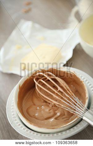 Cooking chocolate cream on kitchen