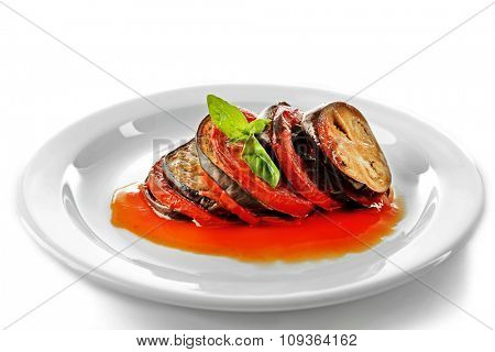 Ratatouille on plate, isolated on white