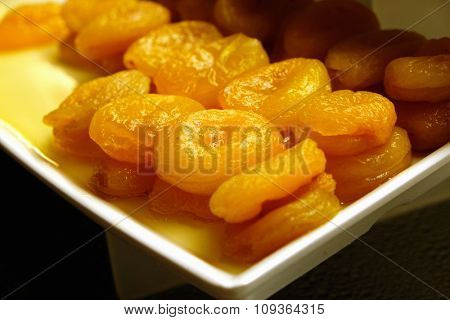 Dried apricots on the plate, close-up