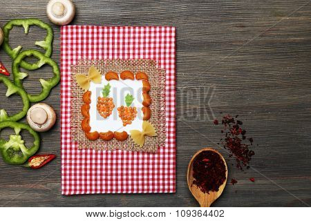 Decorated composition of recipe book and ingredients on wooden background
