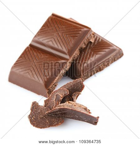 Dark chocolate pieces isolated on white