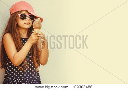 Little Girl Kid Eating Ice Cream. Summer Holidays.