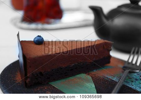 Cup of tea and cake on a table in cafe