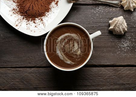 Cup of coffee with kisses on wooden background