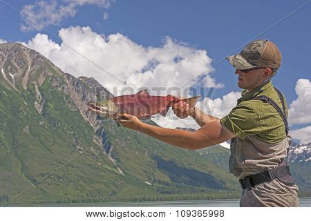 Fisherman Holding A Sockeye Salmon
