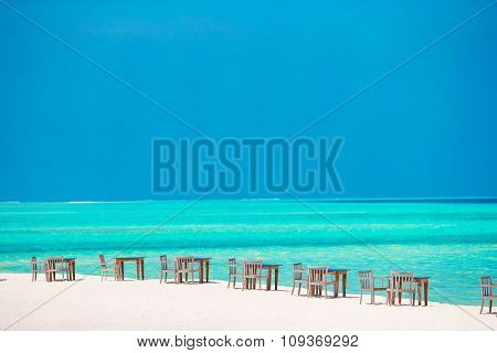 Summer empty outdoor cafe on shore at exotic island in indian ocean