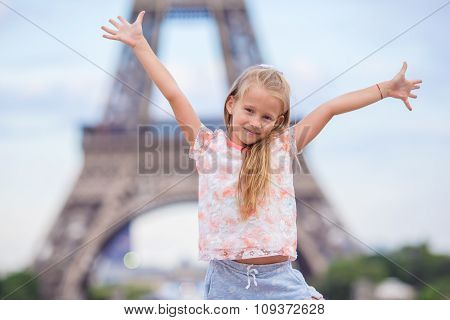 Adorable little girl in Paris background the Eiffel tower during summer vacation