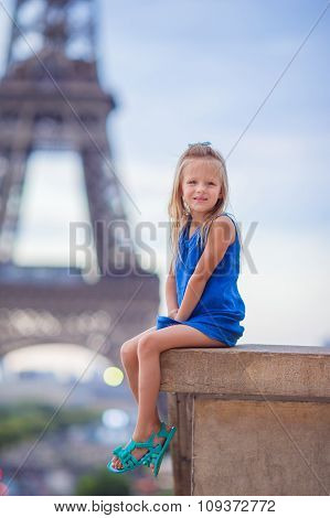 Cute little girl in Paris background the Eiffel tower during summer vacation