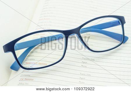 Eyeglasses On Open Diary Planner.