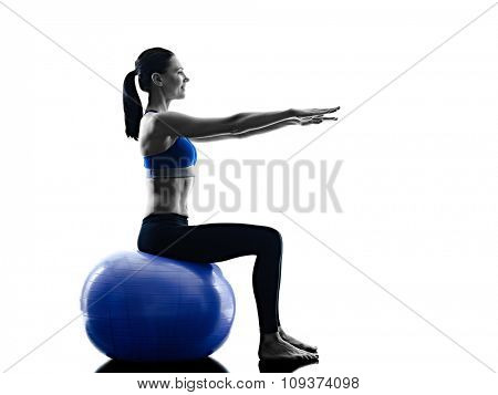 one caucasian woman exercising pilates ball exercises fitness in silhouette isolated on white backgound
