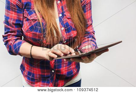 Woman hold tablet on grey background