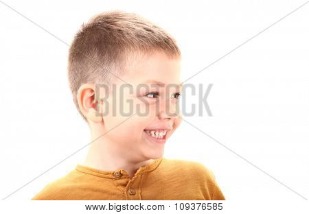 Boy is smiling and looking left