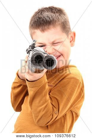 Boy aim with toy gun old rifle