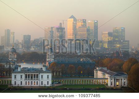 London, UK - October 31, 2015:  Panorama of Canary Wharf in night. View includes the park, Royal