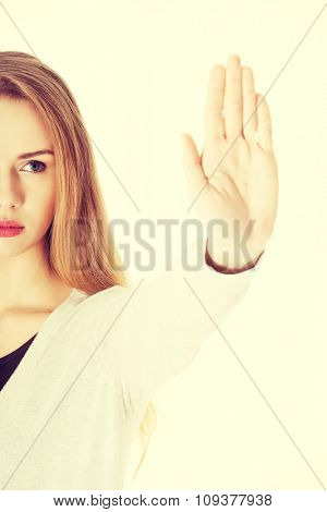Serious woman gesturing stop sign