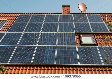 Solar Panel On A Red Roof - Solar panel on a red roof - alternative energy source
