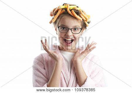 Portrait Of A Cute Girl In A Bathrobe And Curlers..