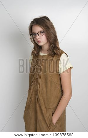Cute Little Girl In Stylish Suede Dress..