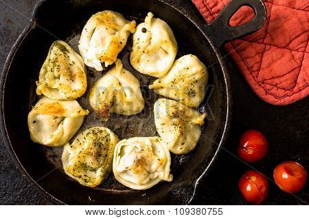 Fried Russian Pelmeni With Meat In A Frying Pan.