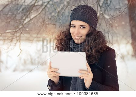 Winter Woman with Tablet Outside in the Snow