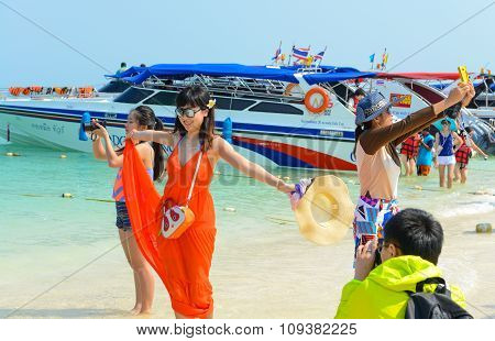 Tourists Are Shooting Pictures On The Beach.