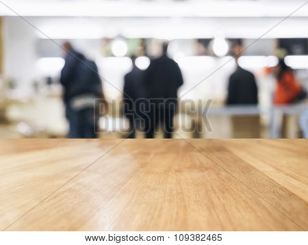 Table Top With Blurred People Shopping in store