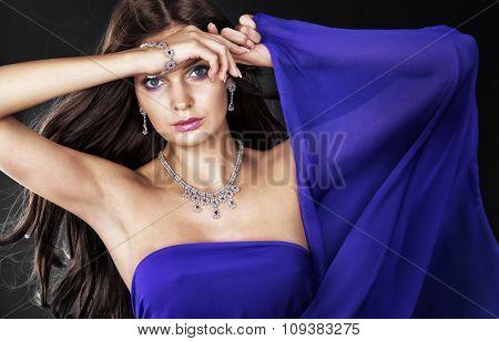 Portrait of beautiful woman with jewelry.