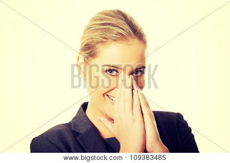 Laughing woman covering her mouth.