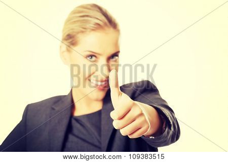 Businesswoman with thumbs up gesture.