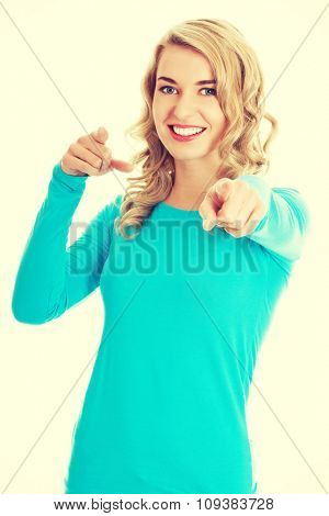 Laughing blonde woman pointing on you.