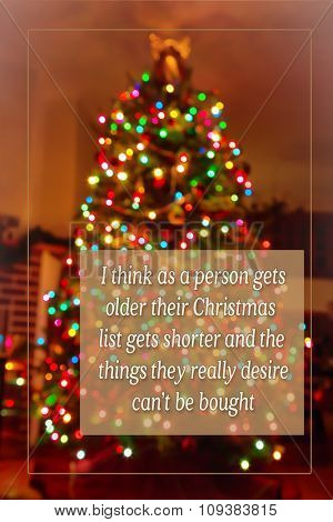 An inspirational Christmas quote on a blurred background.