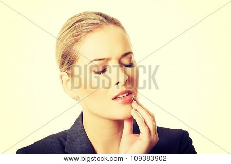 Portrait of young woman with toothache.