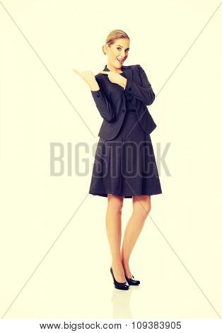 Business woman pointing at copyspace on the right.