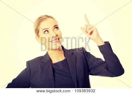 Business woman pointing at copyspace.