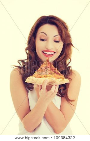 Front view of a woman eating pizza.
