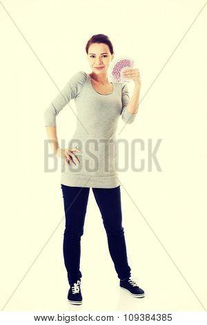 Happy woman holding euro bills.