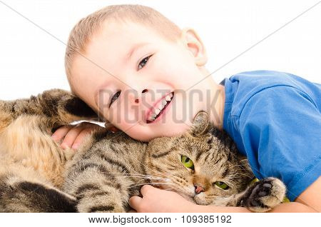 Boy and cat Scottish Straight hugging