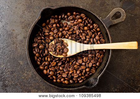 Spoon Roasting Coffee Beans In A Pan